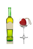 Wine bottle and an empty glass stock photo