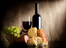 Wine bottle and food Royalty Free Stock Photography