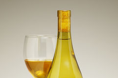 Wine Bottle with galss. White wine bottle with glass behind Royalty Free Stock Photos