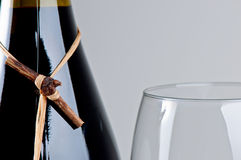 Wine bottle and glass. Full wine bottle and glass close up Stock Images