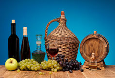 Wine bottle and glass, apples and grapes Royalty Free Stock Photography