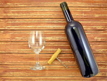 Wine bottle and glass on background wooden slats Stock Photo