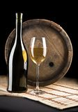 Wine bottle, glass and barrel Stock Images