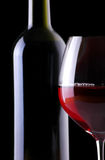 Wine bottle and glass on black Royalty Free Stock Photos
