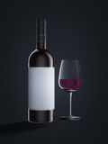 Wine bottle with glass. On black background Royalty Free Stock Photography