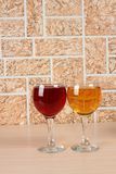 Wineglass on brick four. Wine bottle and glass on brick wall background stock photo