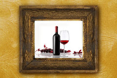 Wine bottle glass bunch red grapes old picture frame Royalty Free Stock Photos