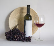 Wine bottle with glass of cabernet  wine Royalty Free Stock Photos