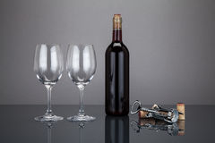 Wine bottle and glass with corckscrew Stock Photos