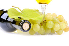 Wine bottle, glass and grapes. Isolated on white background Royalty Free Stock Images