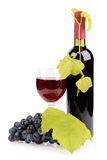 Wine bottle, glass and grapes Stock Images