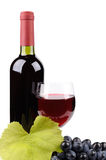 Wine bottle, glass and grapes Stock Photos