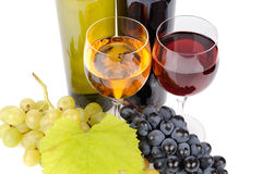 Wine bottle, glass and grapes. Isolated on white background Stock Photo