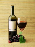 Wine bottle,glass & grapes Stock Image