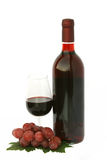 Wine bottle and glass with grapes. A wine bottle and a glass with grapes Royalty Free Stock Photo