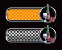 Wine bottle, glass, and grapes on checkered tabs Royalty Free Stock Photos