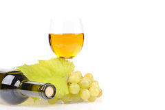 Wine bottle with glass and green grapes Stock Image