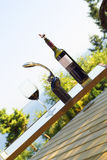 Wine bottle and glass outdoor Stock Photos