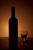 Wine bottle and glass over vintage background Royalty Free Stock Photography