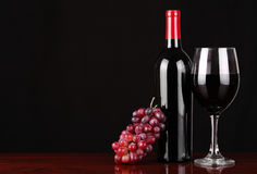 Wine Bottle and Glass of Red Wine with Fresh Grape Stock Photos