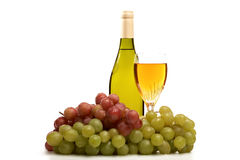 Wine bottle and glass of wine with grapes isolated Royalty Free Stock Photos