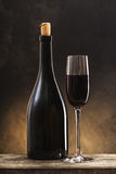 Wine bottle and glass. On a wooden background Royalty Free Stock Images