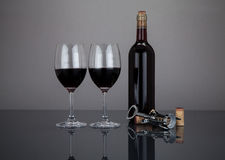 Wine bottle and glasses with corckscrew Royalty Free Stock Images