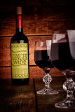 Wine bottle with glasses filled with wine Royalty Free Stock Photography