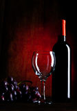 Wine Bottle With Glasses And Grapes Stock Photos