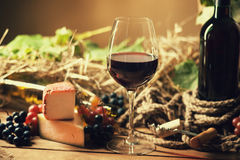 Wine bottle, glasses, grapes and cheese. On a table Royalty Free Stock Images