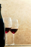 Wine bottle with glasses of red wine out of flocus Royalty Free Stock Photo