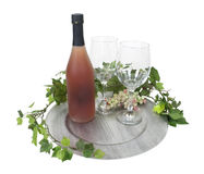 Wine Bottle and Glasses on Silver Charger Royalty Free Stock Photos