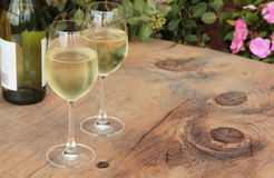 Wine Bottle & Glasses of Wine on Outdoor Table Royalty Free Stock Photos