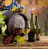 Wine bottle and glasses on wooden table Royalty Free Stock Image