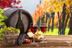 Wine bottle and glasses on wooden table Stock Image