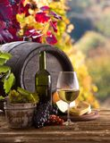 Wine bottle and glasses on wooden table Stock Photography