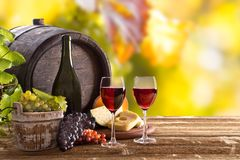 Wine bottle and glasses on wooden table Stock Photo