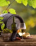 Wine bottle and glasses on wooden table Royalty Free Stock Photos