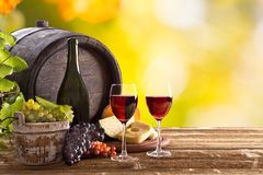 Wine bottle and glasses on wooden table Royalty Free Stock Photo