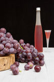 Wine bottle and grape Stock Images