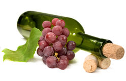 Wine bottle and grapes Stock Photos
