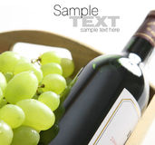Wine bottle and grapes. Fresh grapes and wine bottle arrangement. Room for text available Stock Photo