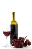 Wine bottle, grapes and glass Stock Photography