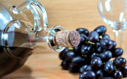 Wine bottle. With grapes and glass royalty free stock photo