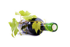 Wine Bottle and grapes with leaves. Royalty Free Stock Image