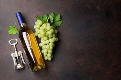 Wine bottle and grapes. On stone table. Top view with space for your text Stock Images