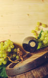 Wine bottle and green grapes Stock Photos