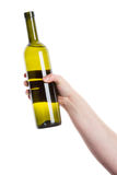 Wine bottle in the hand Royalty Free Stock Photography