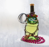 Wine bottle with jewelry near frozen window Royalty Free Stock Photography
