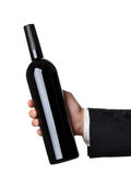 Wine bottle. Man in suit holding red wine bottle isolated on white background Stock Images